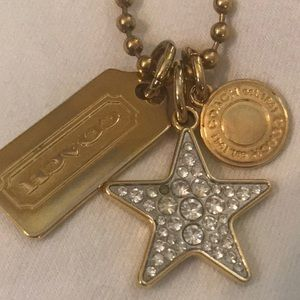 Coach gold necklace with three charms